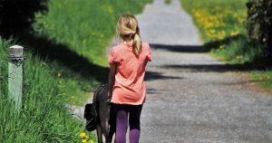 Precious Pet Cemetery - Girl Walking Her Dog